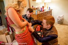 getting ready,groomsmen,red sari,indian wedding