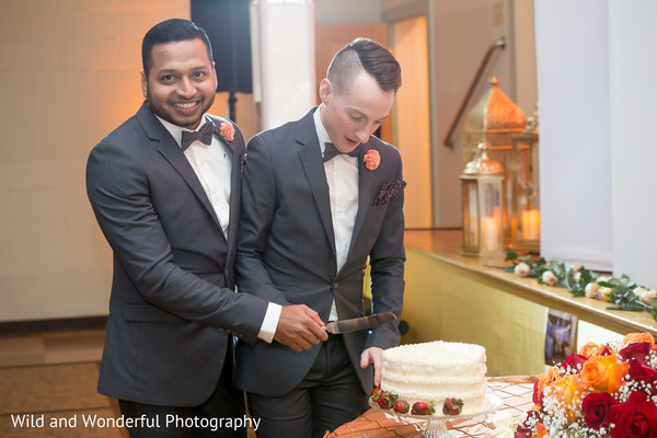 Enchanting gay Indian wedding cake cutting moment.
