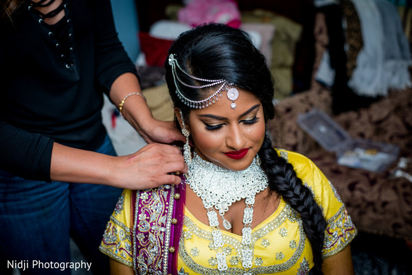 indian bride hair and makeup,indian bride getting ready,indian bride accessories,bridal tikka