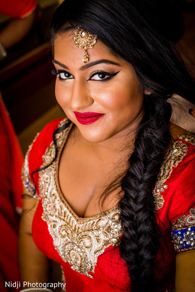 indian bride hair and makeup,bridal tikka