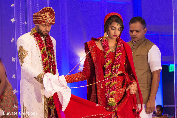 Indian couple getting married. in Atlanta, Georgia Indian Wedding by Elevate Creations