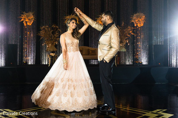 Amazing Indian lovebirds reception outfits. in Atlanta, Georgia Indian Wedding by Elevate Creations