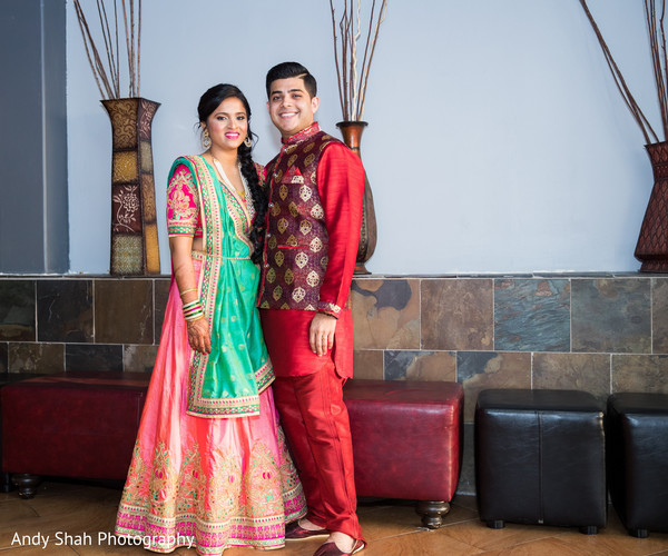 Beautiful Indian bride and groom in sangeet wear.