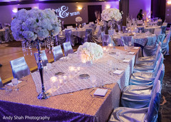 Lavish Indian wedding reception floral and decor.