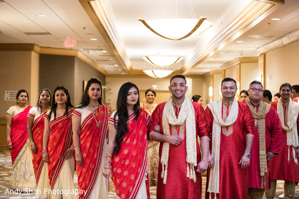 Red and cream indian wedding party wear.
