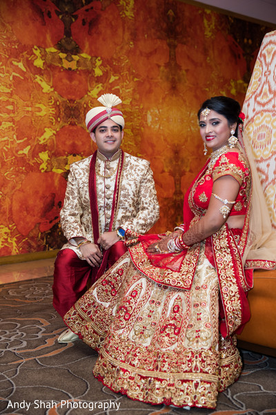 Indian couple's traditional red wedding wear.