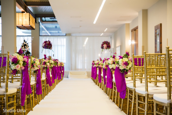 Floral bouquets on the ends of the ceremony rows.