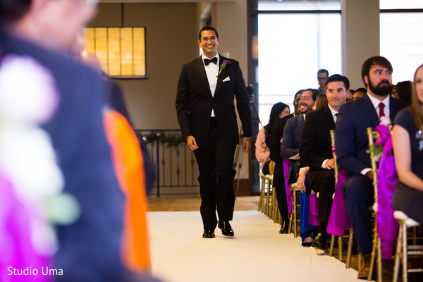 Indian groom making his entrance to the Christian ceremony.