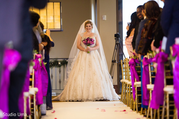 Breathless bride waking down the aisle.