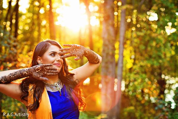 Dazzling indian bride showing mehndi art