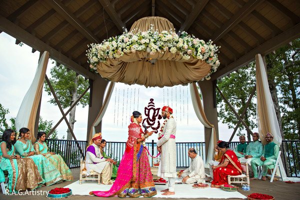 indian groom outfit,indian bride fashion,flower mandap,indian wedding ceremony