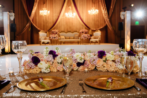 indian wedding reception,floral and decor,sweetheart table.