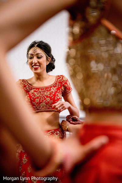 indian bride getting ready,indian bride lengha,bridal tikka
