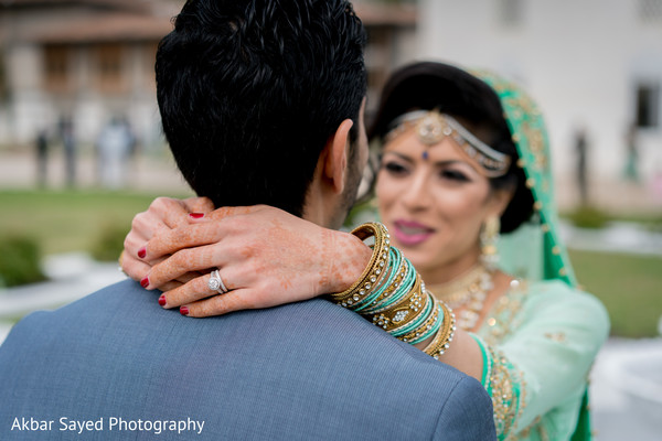 Lovely indian bride and groom looking at each other