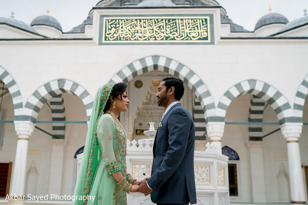 Charming indian bride and groom during their first look