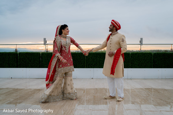 indian bride and groom,outdoor photography,indian groom outfit,indian bride fashion