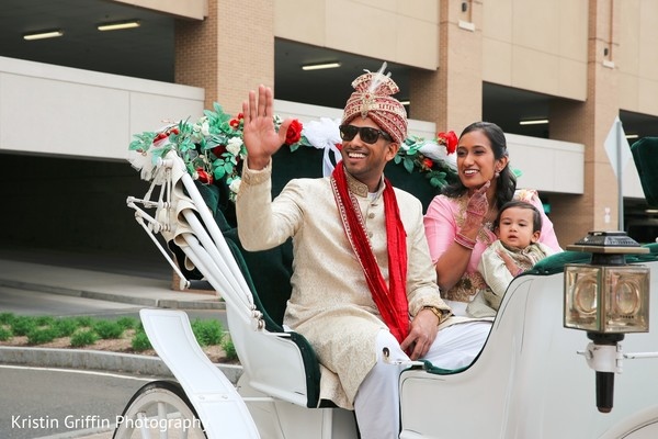 Indian groom in a white baraat carriage. in Hartford, CT South Asian Wedding by Kristin Griffin Photography