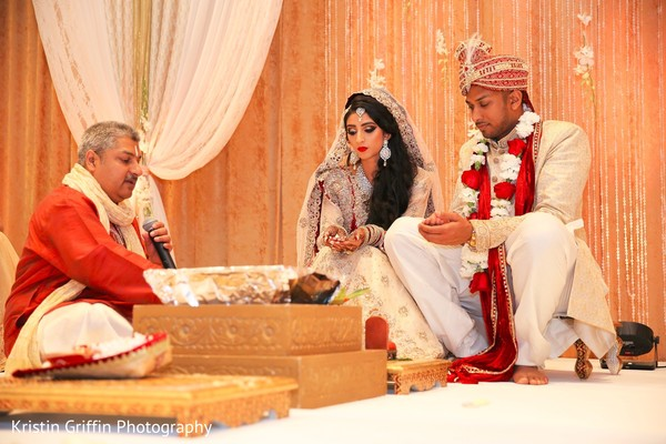 Indian bride and groom at their wedding ceremony. in Hartford, CT South Asian Wedding by Kristin Griffin Photography