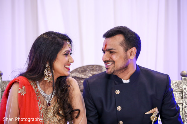 Lovely indian bride and groom looking at each other in Dayton, OH Indian Wedding by Shan Photography