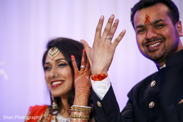 Indian bride and groom showing indian wedding rings in Dayton, OH Indian Wedding by Shan Photography
