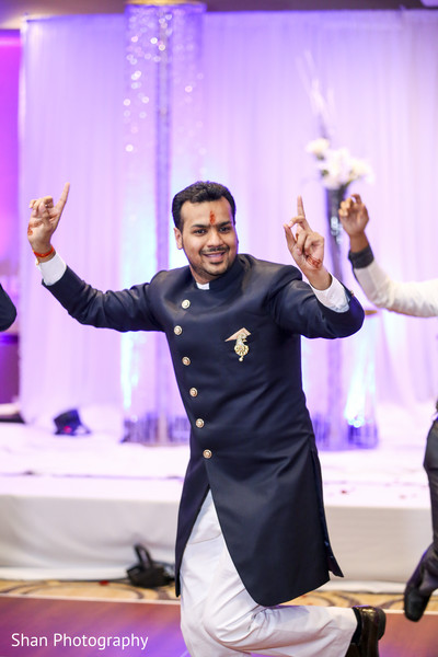 Indian groom dancing at wedding reception party in Dayton, OH Indian Wedding by Shan Photography