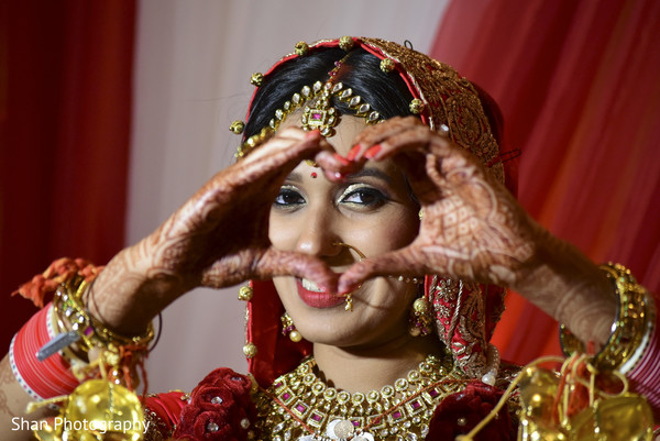 Lovely indian bride showing her bridal mehndi in Dayton, OH Indian Wedding by Shan Photography
