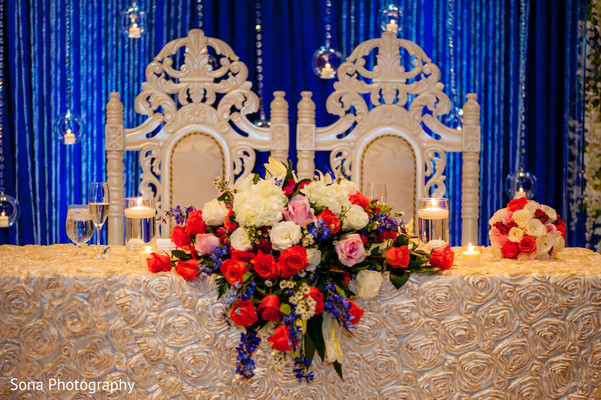 indian wedding reception,sweetheart table,floral and decor