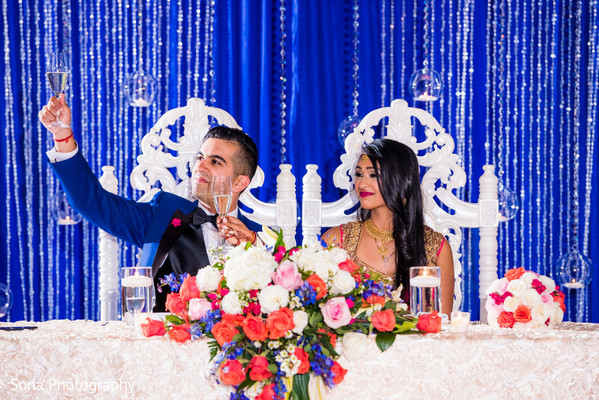 indian wedding reception,indian bride,indian groom,floral and decor
