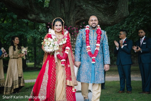 Indian bride and groom leaving wedding ceremony in Long Island, NY South Asian Wedding by Karim Photo