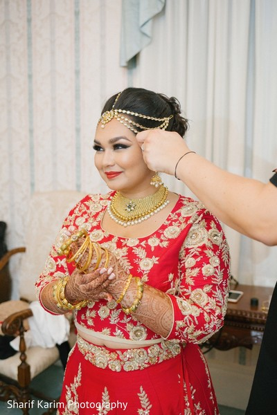 Indian bride getting ready for wedding reception in Long Island, NY South Asian Wedding by Karim Photo
