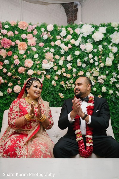 Indian bride and groom enjoying their wedding reception in Long Island, NY South Asian Wedding by Karim Photo