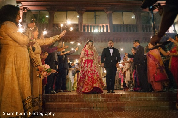 Indian bride and groom leaving wedding reception in Long Island, NY South Asian Wedding by Karim Photo