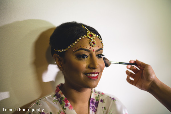 indian bride,indian bride getting ready,indian bridal makeup