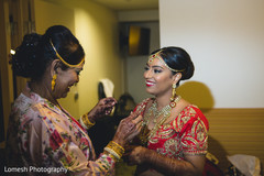 indian bride getting ready,indian bride hair and makeup,bridal jewelry,bridal tikka
