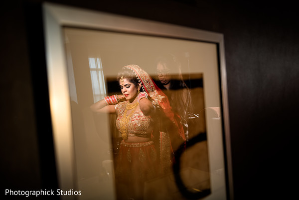 Gorgeous indian bride reflection.