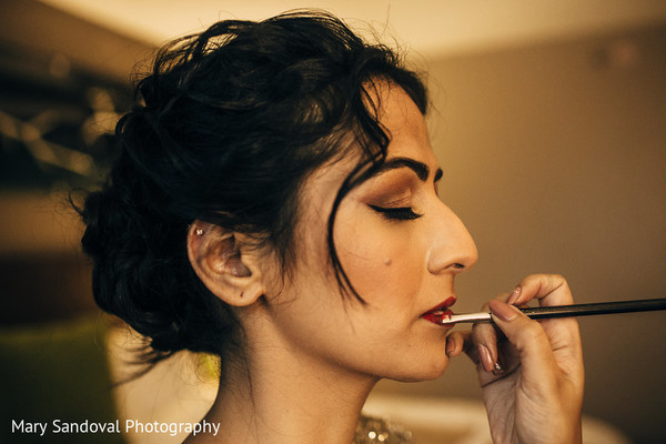 indian bride getting ready,indian bridal makeup,indian bride