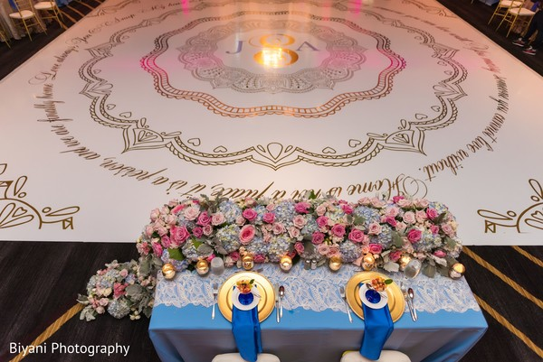 indian wedding reception,floral centerpieces,indian wedding reception floral and decor,monogrammed dance floor.