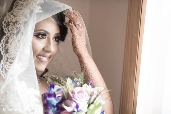 indian bride,bridal bouquet,white wedding dress,mehndi