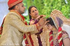 sindhoor wedding ritual,indian wedding ceremony,indian groom sherwani,indian bride lengha