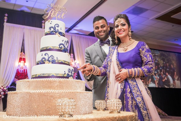 indian bride and groom,indian wedding reception,wedding cake,cake topper