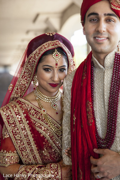 red bridal lengha,beige sherwani,indian couple
