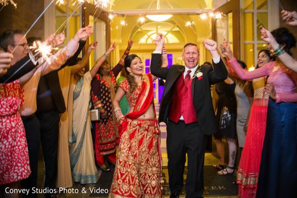indian wedding reception,indian bride,indian groom,fireworks,sparklers