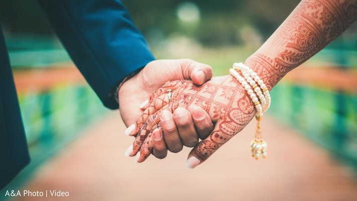 Indian Couple Holding Hands In Texas Pakistani Wedding By