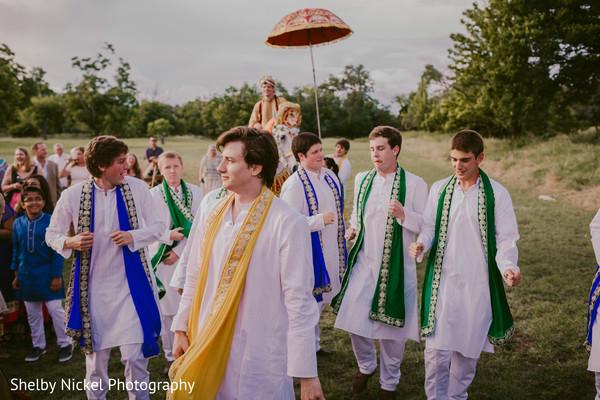 Indian groomsmen during wedding baraat