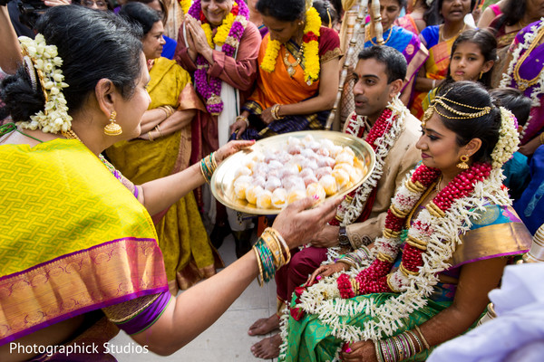 Indian bride and groom during mehndi party