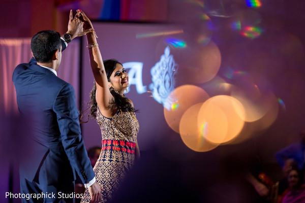 Enchanting indian bride and groom dancing