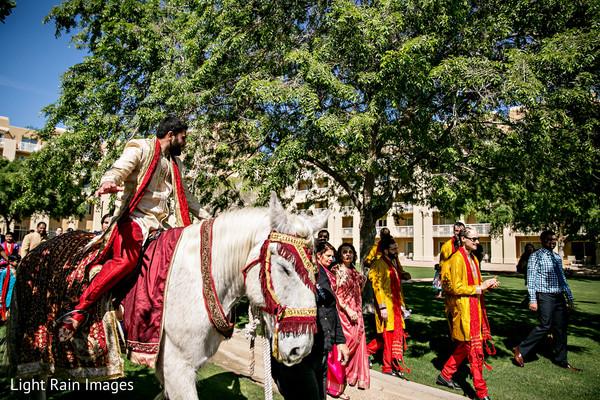 Indian groom on white horse for Baraat