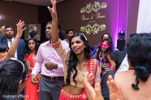Indian bride dancing at the reception.