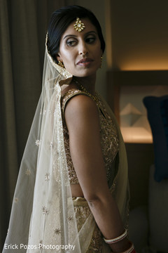 Stunning indian bride wearing a golden lengha