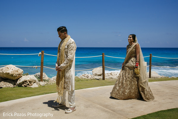 First look of groom waiting for bride in Cancun, Mexico Destination Indian Wedding by Erick Pozos Photography